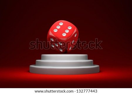 Red dice on the white round podium - stock photo