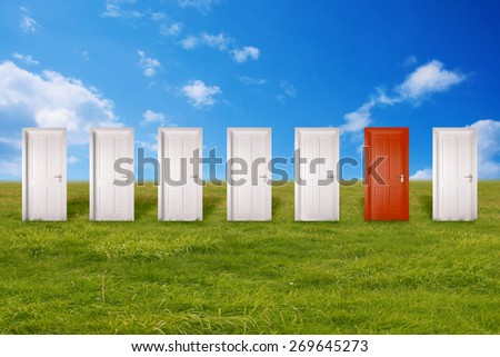 Red door among many white ones  - stock photo