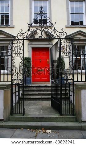 red door on luxury townhouse - stock photo