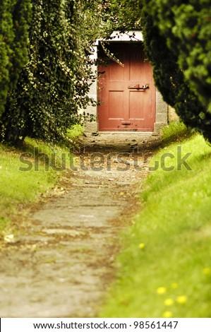 Red Door on Path - stock photo
