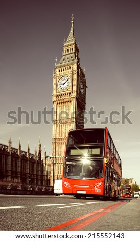 Red doubledecker bus in front of Big Ben in London, toned image - stock photo
