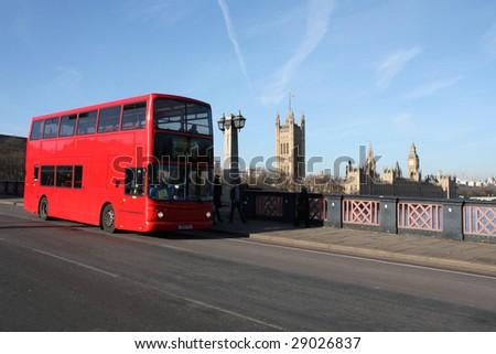 Red doubledecker bus, Victoria Tower, Houses of Parliament and Big Ben seen from Lambeth Bridge over river Thames in London, England - stock photo