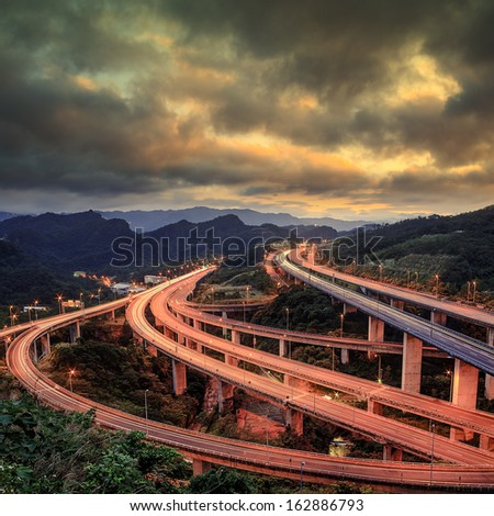 red dramatic sunset over highway  - stock photo