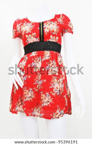 red dress on a dummy  (white background) - stock photo