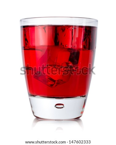 Red drink with ice cubes in a glass isolated on a white background - stock photo