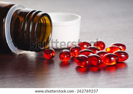 red drugs and pills on the table - stock photo