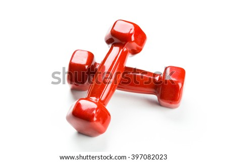 Red dumbbells isolated on white - stock photo