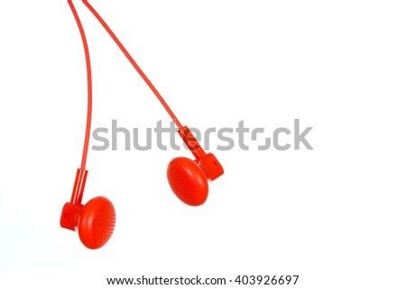 Red ear buds isolated on white bacnground - stock photo