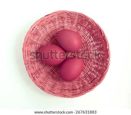 Red eggs in basket from top view - stock photo
