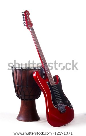 red electro guitar and japanese drum - stock photo