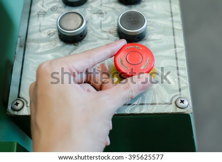 Red emergency stop switch of machine. - stock photo