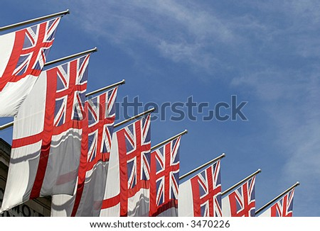 Red Ensigns on Admiralty Arch in London. - stock photo