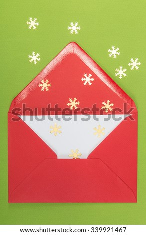 red envelope on green and snowflakes background - stock photo