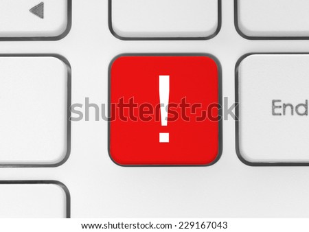 Red exclamation mark button on the keyboard  - stock photo