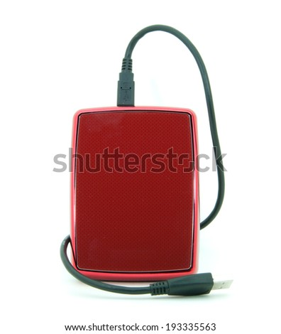 Red external hard drive with usb cable on the white background. The object is deprived of all brand-names. - stock photo