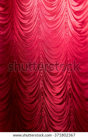 Red fabric curtain as a backdrop. - stock photo