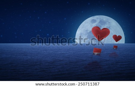 Red fabric heart air balloon on fantasy sea sky and moon, love concept - stock photo