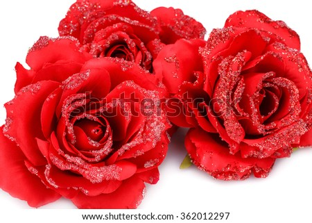 Red fabric roses isolated on white background. - stock photo