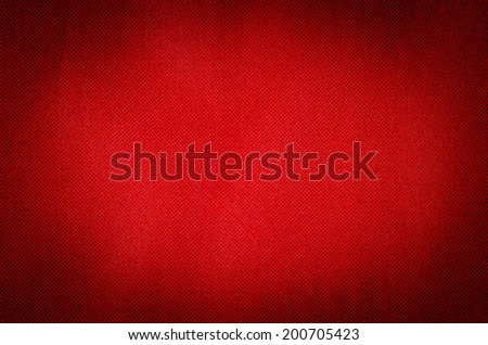 red fabric textile background vignetted - stock photo