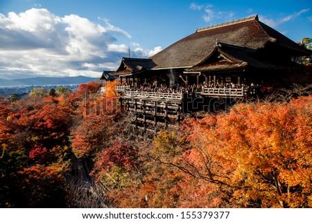 Red fall leaves at Kiyomizu-dera temple in Kyoto, Japan - stock photo