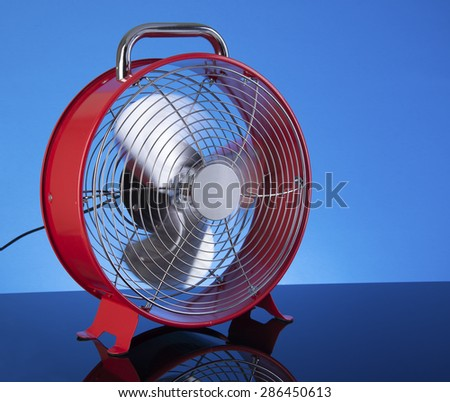 Red Famn on blue background for summer cooling - stock photo