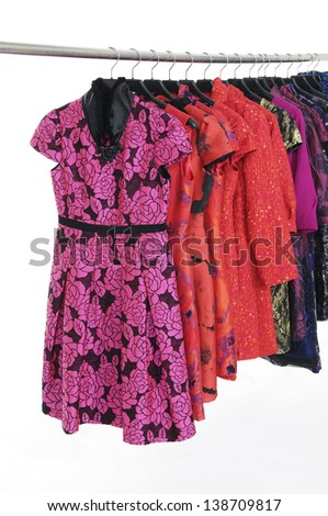 Red female clothing with clothing on hanger in a row  - stock photo