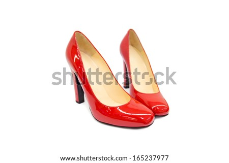 Red female shoes on white background. - stock photo