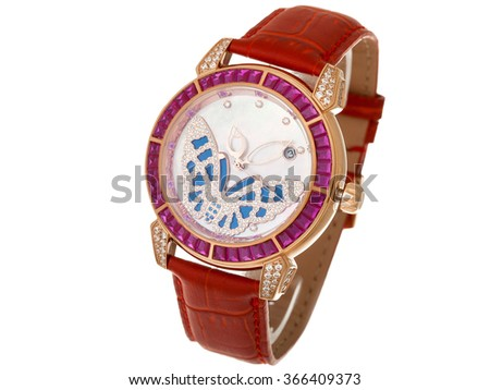 Red Female watch with a leather thong and the dial from gold and jewels, the dial with a butterfly from diamonds. The isolated image on a white background, nobody. - stock photo