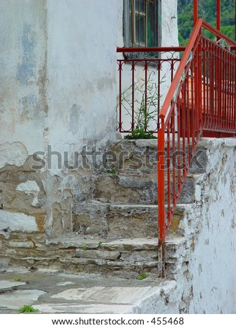 Red fence on the steps of a house in Samos, Greece - stock photo