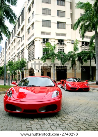 Red Ferrari Enzo and F430 in Singapore - stock photo