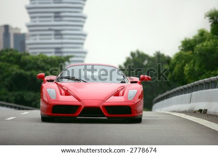 Red Ferrari Enzo on the road in Singapore - stock photo