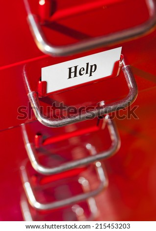 Red file cabinet with card Help - business background - stock photo