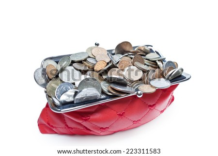 Red filled purse in the drop-down coins on white background - stock photo