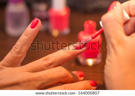 Red finger nails painting  - stock photo