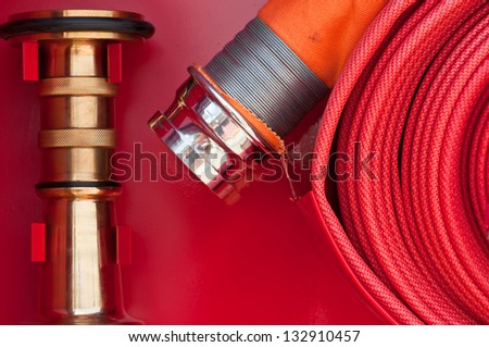 Red fire hose - stock photo