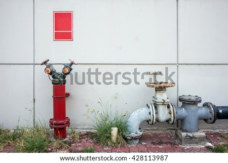 Red fire hose nozzle - stock photo