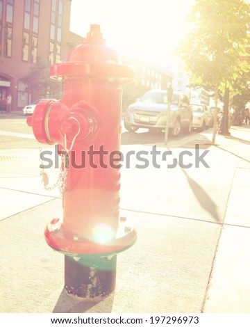 red fire hydrant done with a retro vintage instagram filter  - stock photo