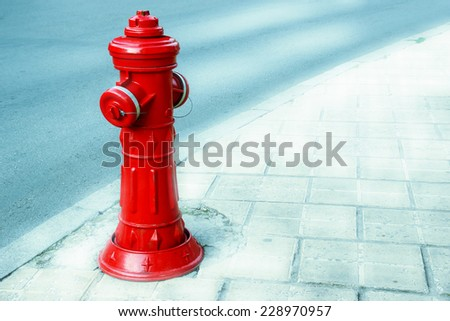 Red Fire Hydrant on City Roadside in Instagram style - stock photo