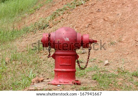 Red Fire Hydrant on the ground - stock photo