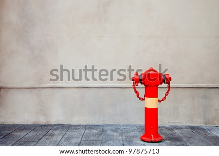 Red fire hydrant over the wall - stock photo