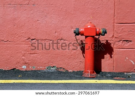 Red fire hydrant, Red connecting hydrant against the wall. - stock photo