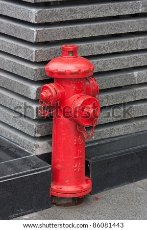 """Red fire hydrant with Chinese letters """"fire hydrant"""" - stock photo"""