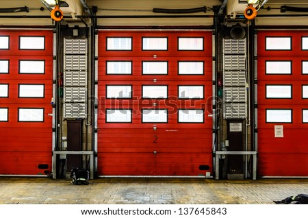 Red Fire Station doors closed at a fire station in England, UK - stock photo