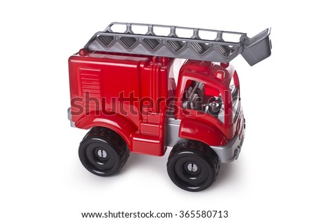 Red fire truck toy isolated on white - stock photo
