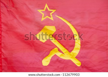 Red flag with hammer and sickle - stock photo