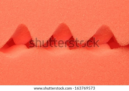 Red foam acoustic, safe packaging material - stock photo