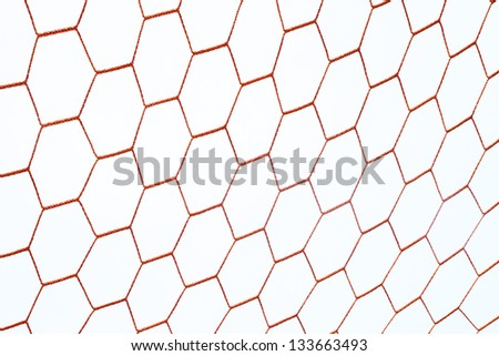 red football net with sky - stock photo