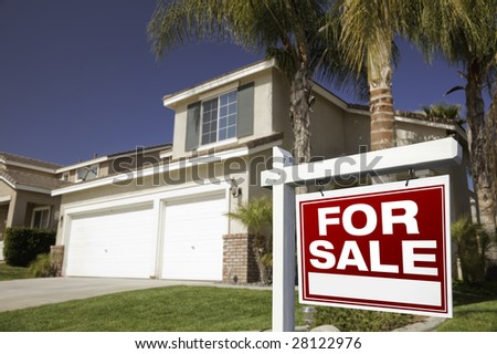 Red For Sale Real Estate Sign in Front of House. - stock photo