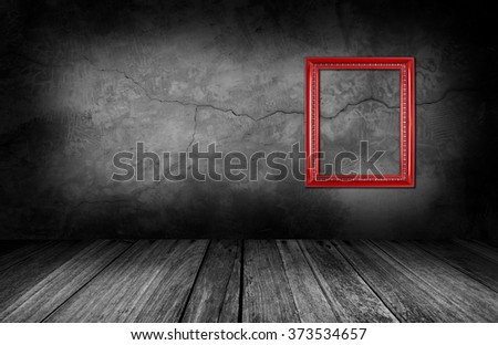 red frame on gray stone wall background in interior room. - stock photo