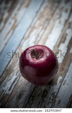 Red fresh apple on old wooden table  - stock photo